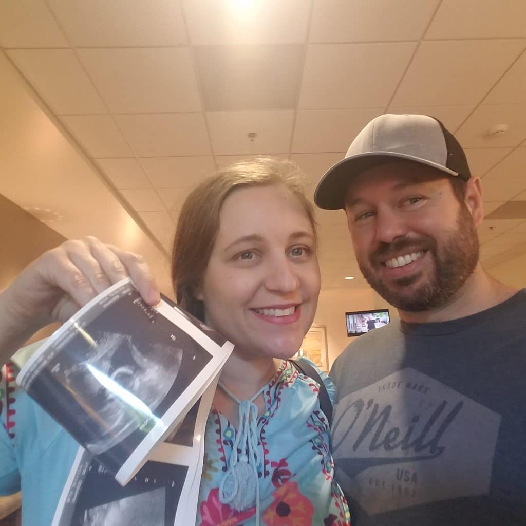 Katie and Scott holding ultrasound results